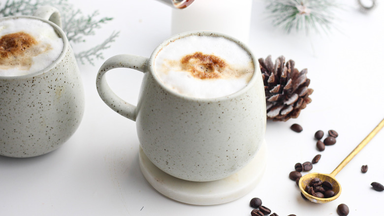 mugs with fresh coffee drinks