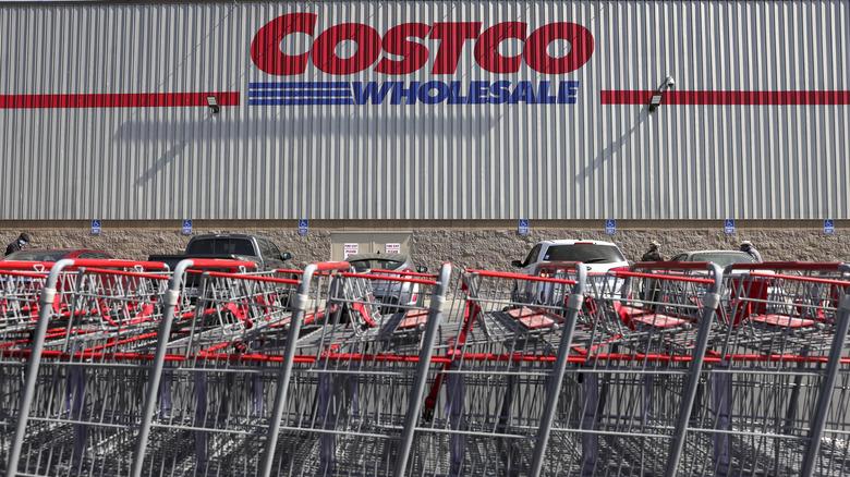 Costco logo on exterior building next to shopping carts