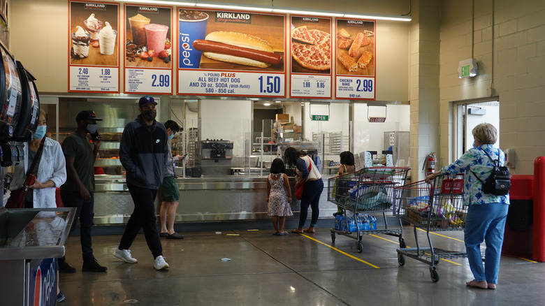 People ordering at the Costco food court