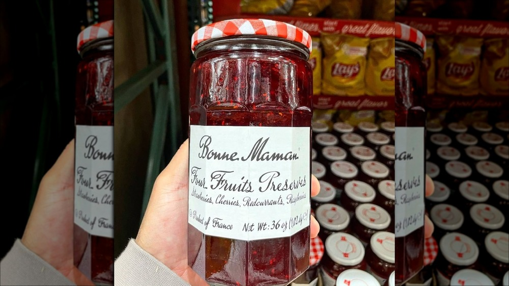 Person holding jar of Bonne Maman Four Fruits Preserves