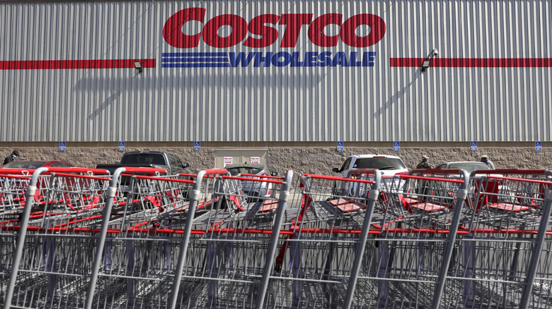 Costco sign with grocery carts