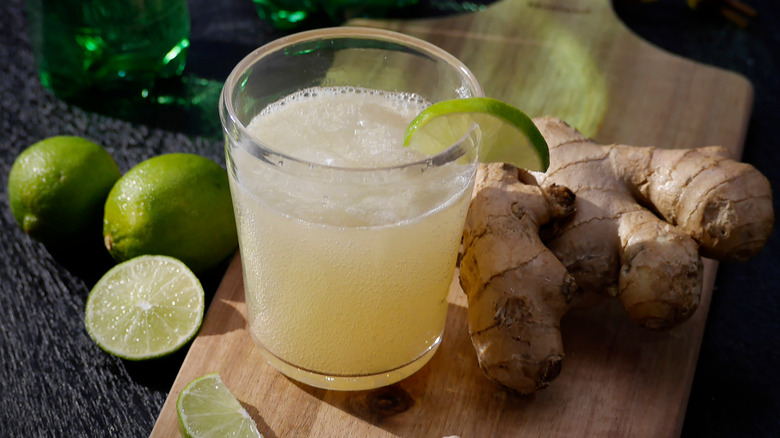 A glass of ginger beer with lime wedge