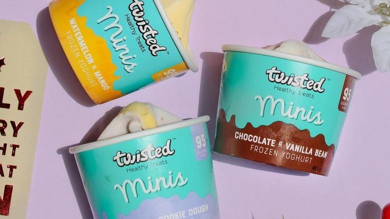 Twisted mini yogurts on a purple background
