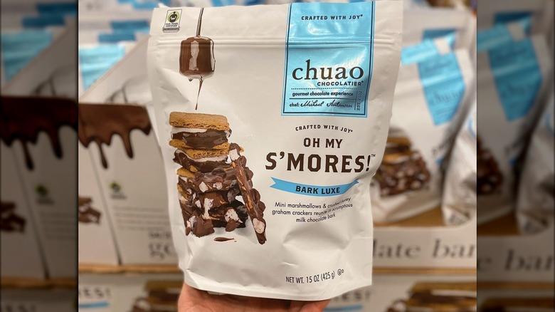 hand holding chuao chocolatier s'mores bark