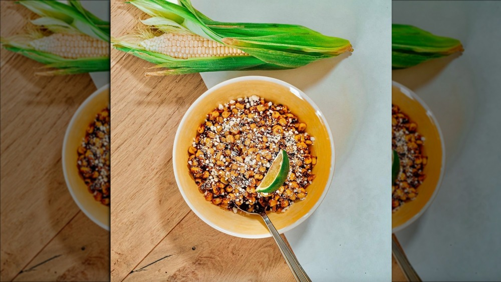 Tattooed Chef Mexican-style street corn in a bowl with lime