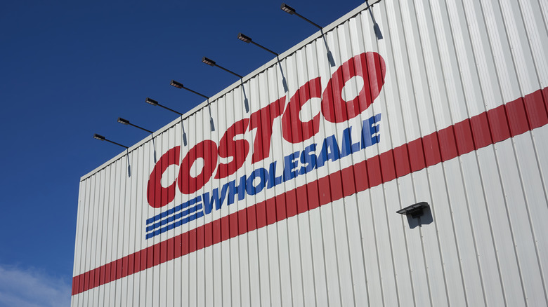 Costco sign against blue sky background