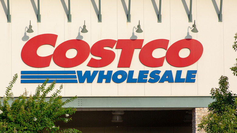 Costco sign with trees in the background