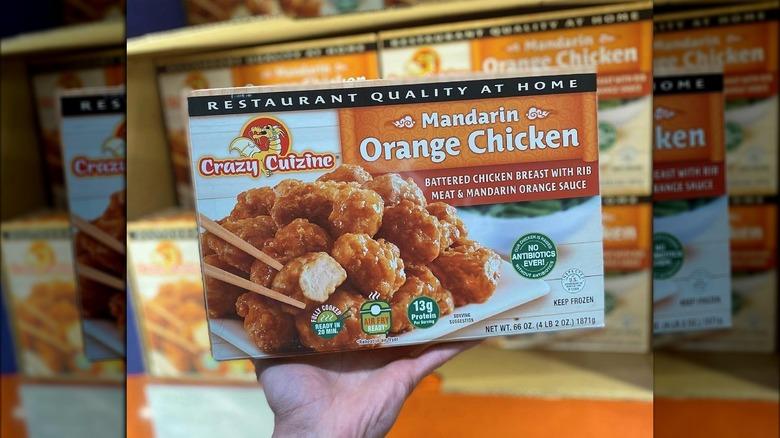 Hand holding Mandarin Orange Chicken from Costco