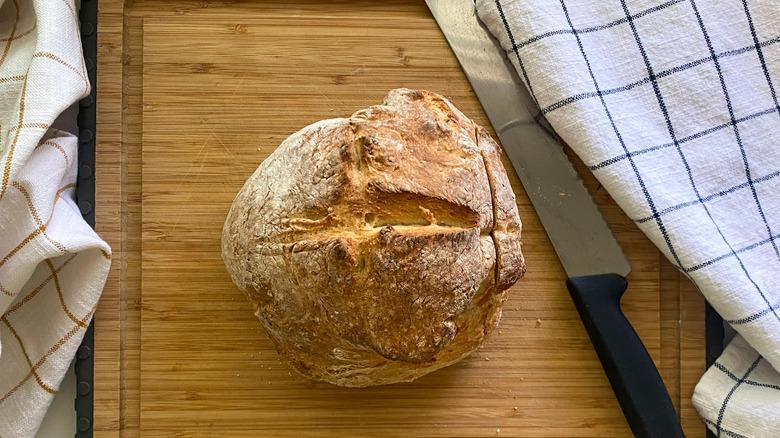 crusty bread on cutting board