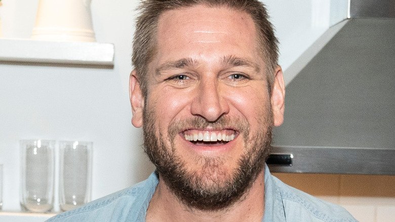 Curtis Stone smiling in kitchen