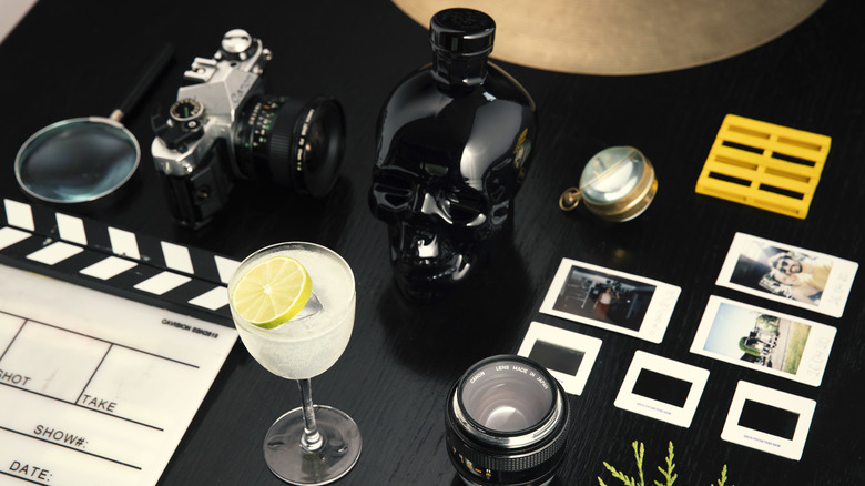 Crystal Head Onyx bottle by camera and glass