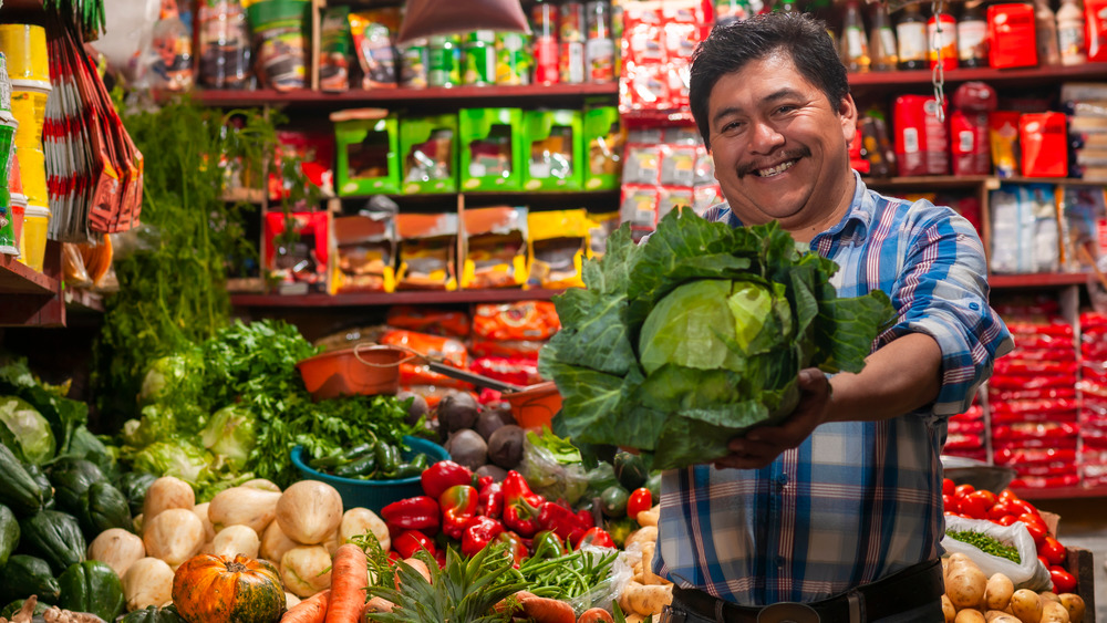 happy man selling cabbage