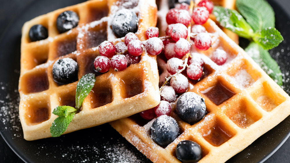 Waffles topped with berries still on vine