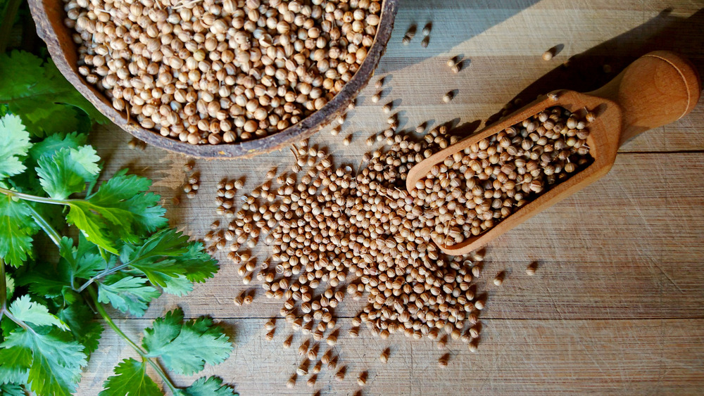 Coriander seeds on a wooden surface