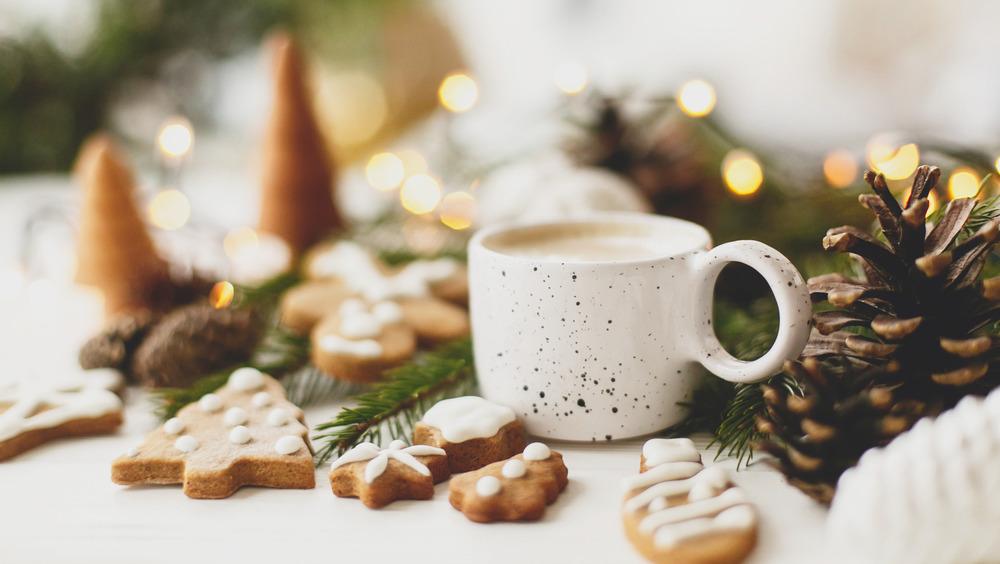 cookies and warm mug with winter decor