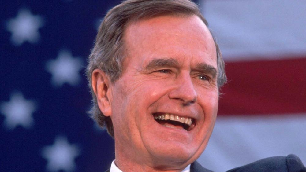 President George H.W. Bush wearing black suit
