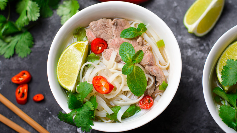 Rice noodles with pork, red chile pepper, lime and mint