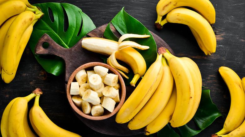 Multiple bananas, some sliced