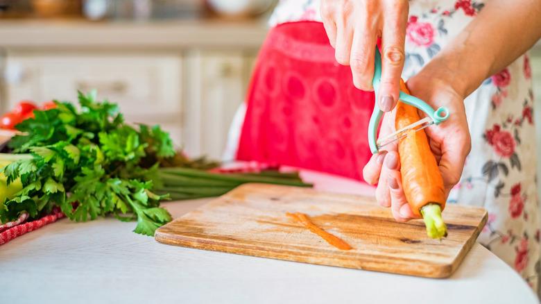 Woman peeling carrots