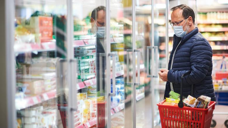 Man in frozen food aisle