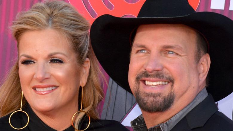 Trisha Yearwood and Garth Brooks smiling