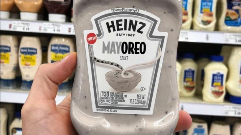 Hand holding bottle of Mayoreo in supermarket aisle