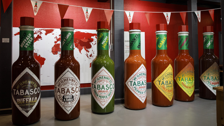 Several large bottles of Tabasco sauces
