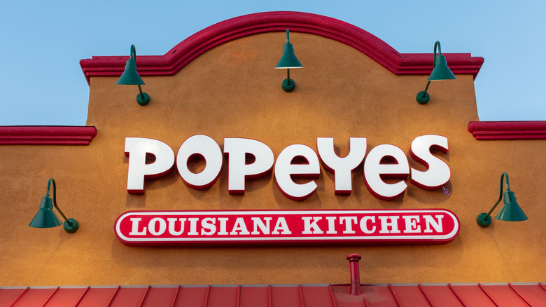 Sign on the front of a Popeyes shop