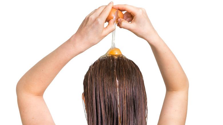 cracking an egg on hair
