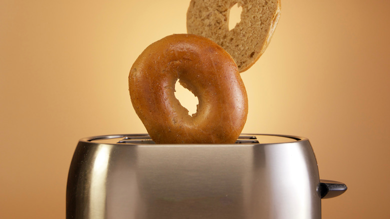 Bagels popping out of toaster