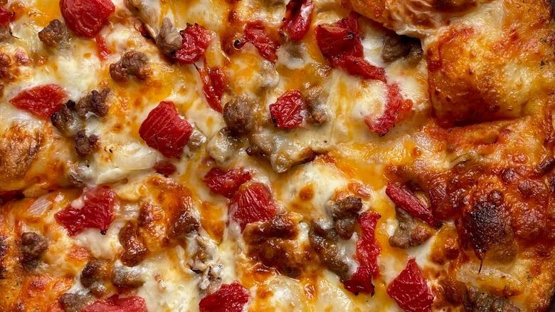 Close-up of Domino's cheeseburger pizza