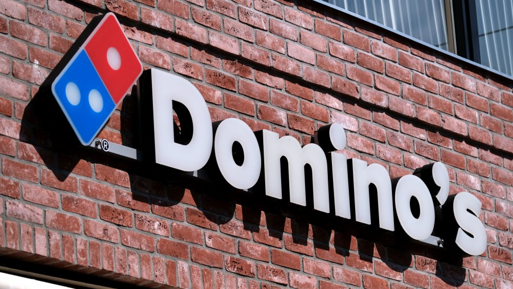 domino's pizza logo against a brick background