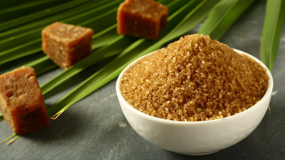 Bowl of brown sugar with cubes in background
