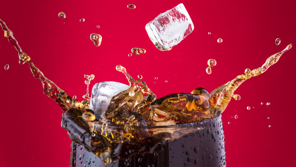 cola and ice cubes in a glass