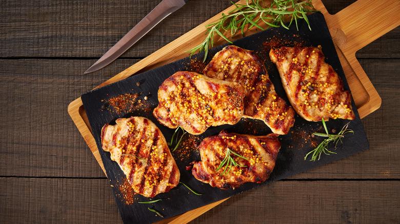 Grilled pork chops on board