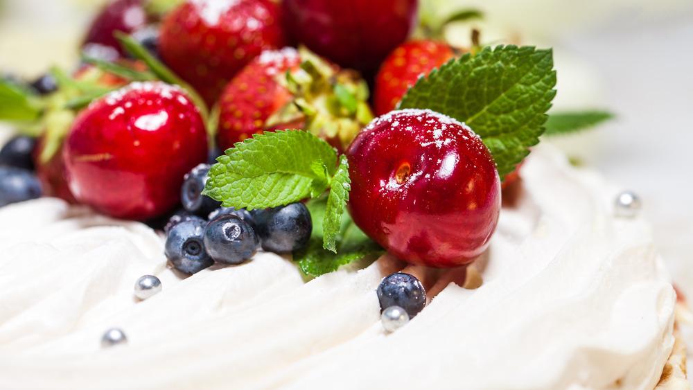 Pavlova with fresh cream and berries