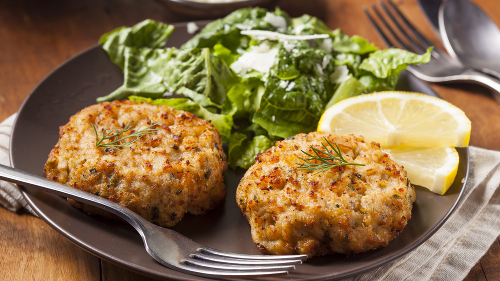 Homemade crab cakes with lemon wedge
