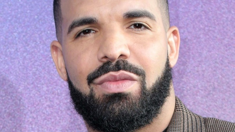 Drake against purple background