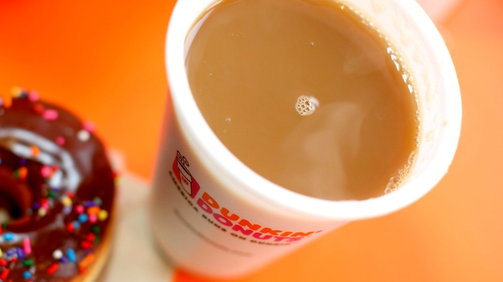 Cups of Dunkin' Donuts hot coffee and iced coffee