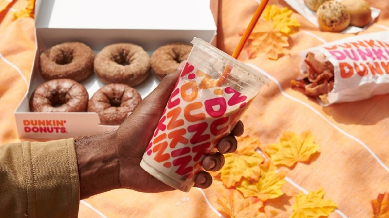 Dunkin' Iced Coffee with fall themed decorations