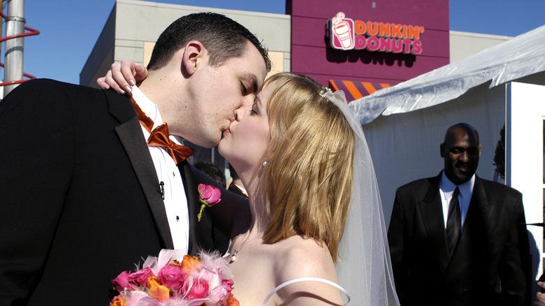 Wedding couple kisses at Dunkin'