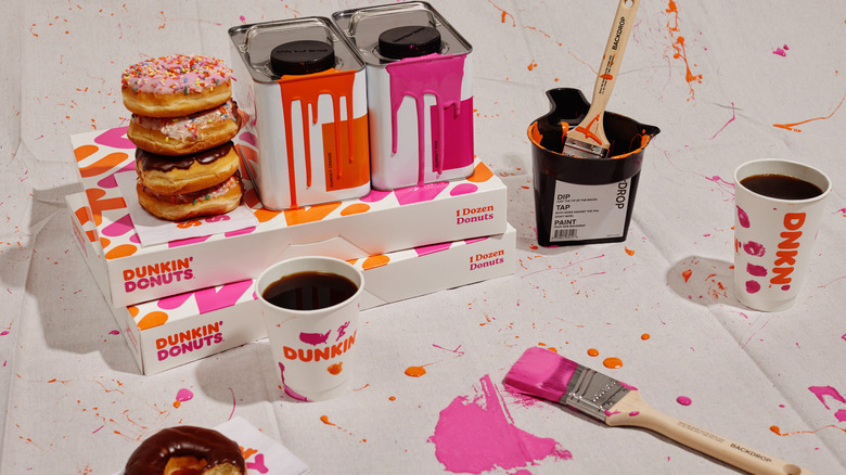 Dunkin' doughnuts and coffee with pink and orange Backdrop paint and paint splatters