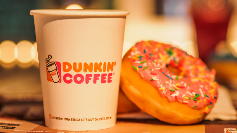 Dunkin' coffee cup and donut