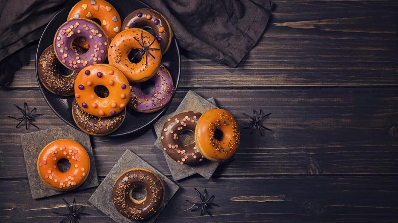 Halloween donuts against a dark wood background