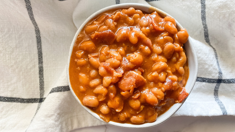 Easy baked beans with bacon on bowl