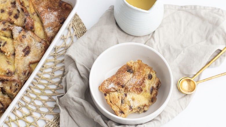 Bread and butter pudding in a dish with custard