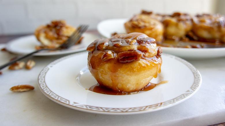 a single caramel pecan sticky bun on a plate