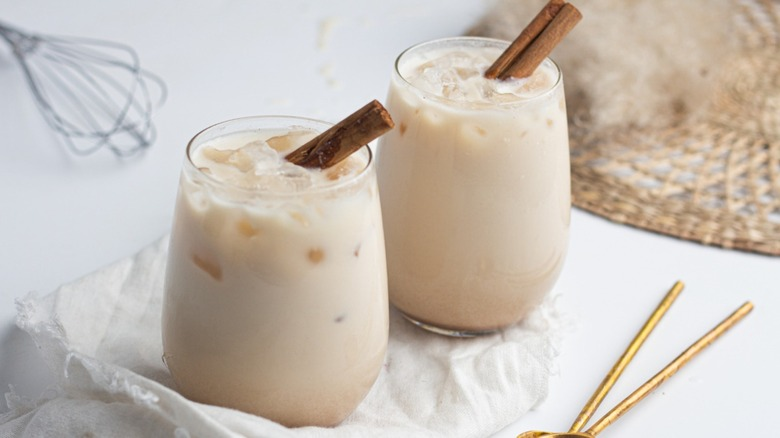 Glasses of horchata with cinnamon sticks