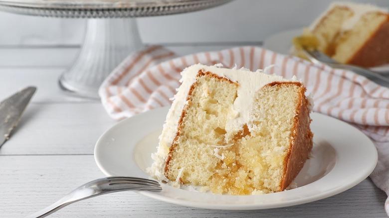cake slice on plate, fork
