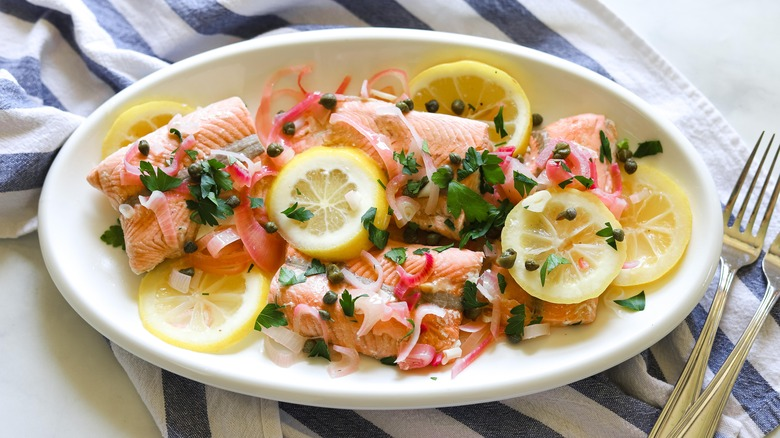 poached salmon with lemon slices